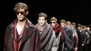 Models wear creations for Salvatore Ferragamo men's Fall-Winter 2015-2016 collection, part of the Milan Fashion Week, unveiled in Milan, Italy, Sunday, Jan. 18, 2015. (AP Photo/Luca Bruno)